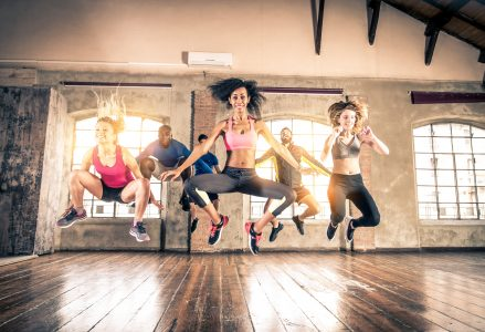 Group of sportive people training in a gym - Multi-ethnic group of athletes doing fitness